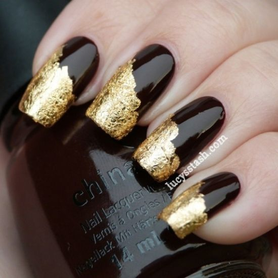 Gold foil design on black nails - 35 Perfect Black And Gold Nail Art Designs