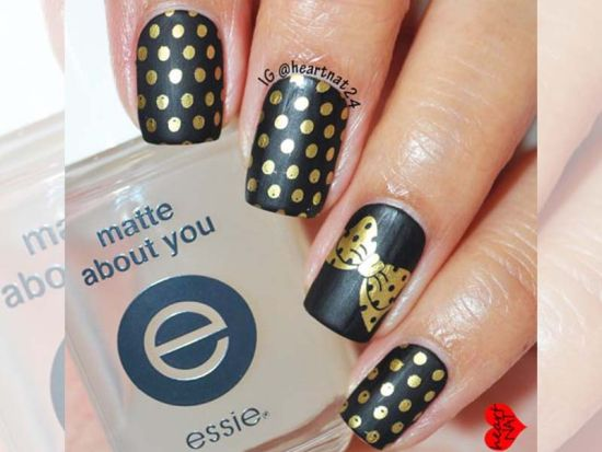 Stylish black and gold nails with polka dots and bow - 35 Perfect Black And Gold Nail Art Designs