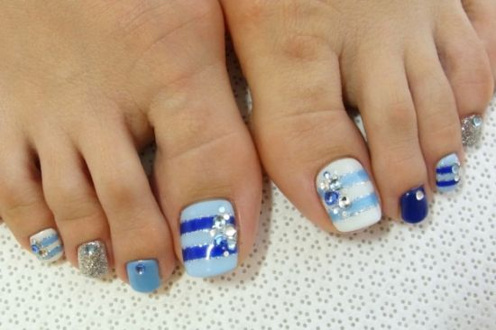 Quirky DIY toe nail art with stripes and studs