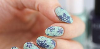 Beautiful Blue Snowflakes On Textured Nails