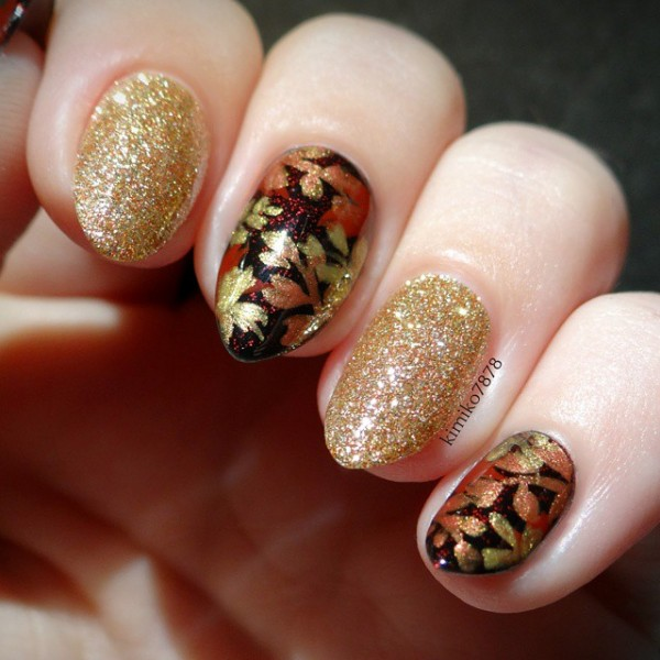 attractive-black-and-gold-pointy-nail