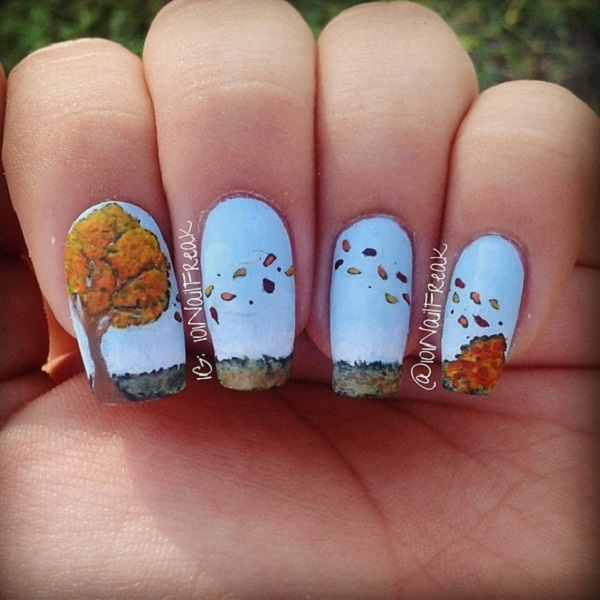blue-base-with-continuous-leaf-nail-art
