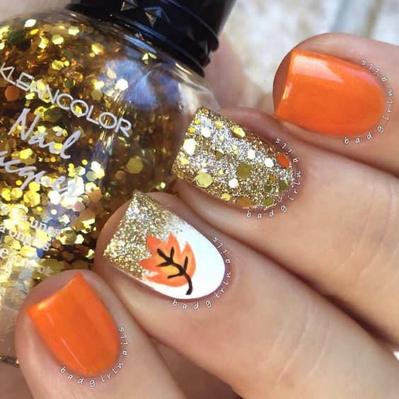Glitters And Maple Leaf Nail Design