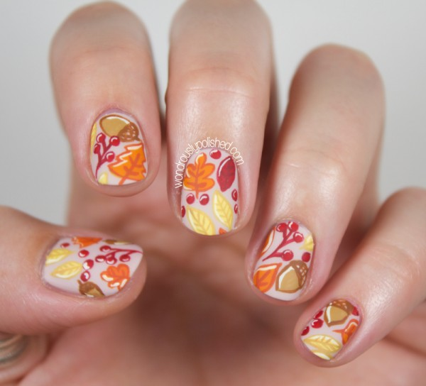 white-base-with-chestnuts-nail-art