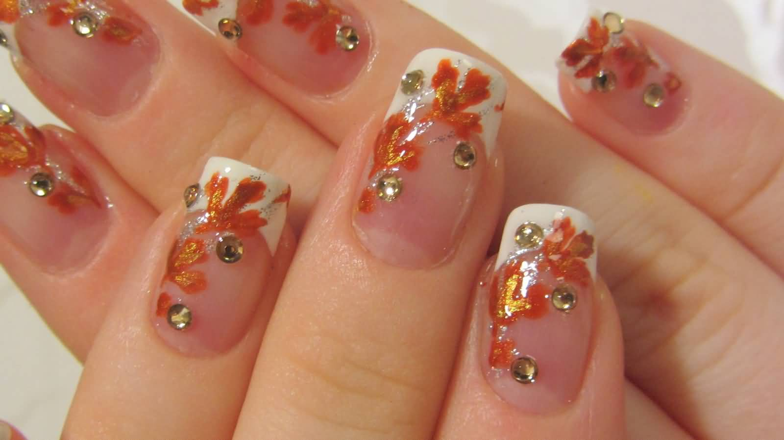 white-tip-with-orange-leaves-nail-art