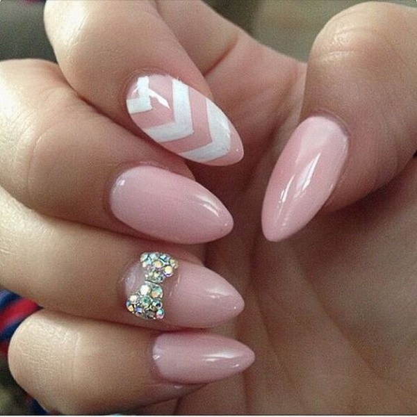31Baby Pink Almond Nails with a Studded Bow and White Chevron Lines - 32 Stunning Almond Nail Design Nail Design Ideaz