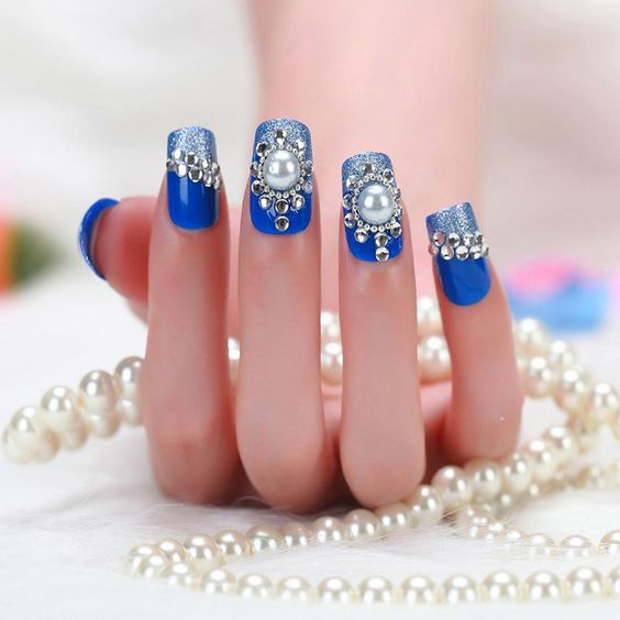 31Sophisticated Rhinestone Layout On Blue Polish - 30 Gleaming Nail Designs With Rhinestones Nail Design Ideaz