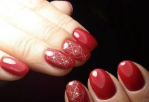 Geometric Pattern On Red Nails